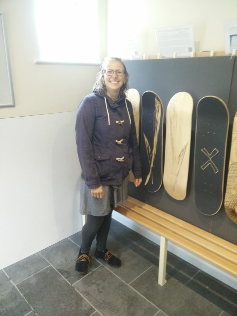 Anna Mawby with her laser engraved skateboard design at the Wirksworth Festival