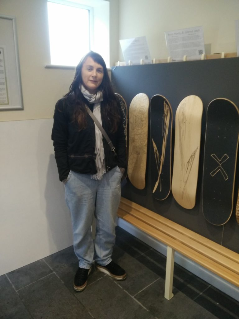 Joanna Leah with her laser engraved skateboard design at the Wirksworth Festival